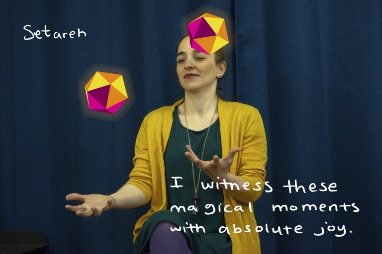 """Artist Eductaor, juggling colour Dodecahedrons sitting in front of curtain.Word written around her read, """"Seterah I witness these moments of absolute joy"""""""